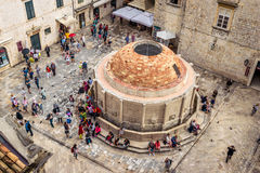 Many tourists visit the Old City of Dubrovnik and the famous Onofrio Fountain. DUBROVNIK, CROATIA - JUNE 13, 2016: Many tourists visit the Old City of Dubrovnik Stock Photography