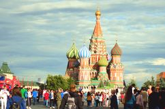 Many tourists walk around Moscow. St Basil`s Church. stock photography