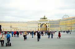 Many tourists walk around the Palace Square in St. Petersburg royalty free stock image