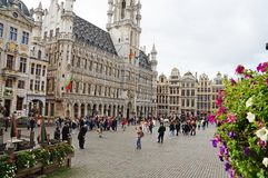 Grand Place in Brussels. Many tourists walk and look at beautiful buildings on the main square in Brussels. Flowers bloom on the Grand Place in Brussels stock photos