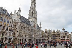 Grand Place in Brussels. Many tourists walk and look at beautiful buildings on the main square in Brussels stock image