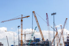 Many tower cranes and worker in construction side Royalty Free Stock Photo