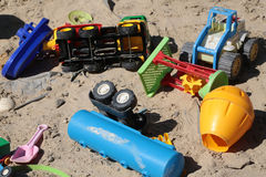 Many toys on sand Royalty Free Stock Photo