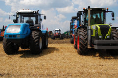 Many tractors on field Royalty Free Stock Image