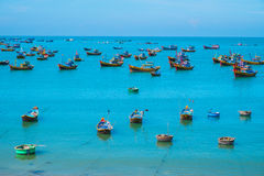 Many traditional boats in fishing village Stock Images
