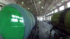 Many trains in a large hangar stock footage