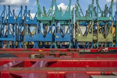 Many transports for reels stacked behind truck trailers with sunshine and small spring clouds. Viele Transportgestelle für Rollen aufgestapelt hinter LKW Stock Photos