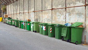 Many trash bins. Lined up next to a cemetery Royalty Free Stock Image