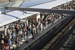 Many travellers wait for train on platform of railway station ut Royalty Free Stock Photos