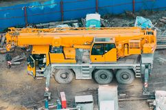 Many Truck and Crane in yard site consist of lifting, pulley, sling, derrick are ready for construction. Stock Image