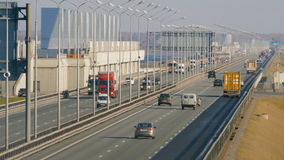 Many trucks and cars driving on long Causeway in Kronstadt. Saint-Petersburg, Russia, 2016. Many trucks and cars driving on long Causeway in Kronstadt stock footage