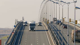 Many trucks and cars go over the bridge. Saint-Petersburg, Russia, 2016. Several trucks and cars driving on the highway in the afternoon stock footage