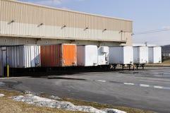 Many trucks unloading royalty free stock photography