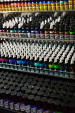 Many tubes of  tattoo paint at showcase Royalty Free Stock Image
