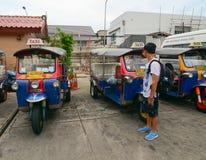 Many tuk tuk taxis parking on the station in Bangkok, Thailand Stock Photography