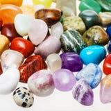 Many tumbled natural mineral gemstones stock photography