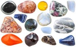 Many tumbled ornamental gem stones isolated Stock Image