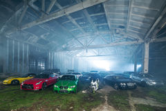 Many tuning sport-cars in hangar Stock Photos