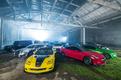 Many tuning sport-cars in hangar Royalty Free Stock Photo
