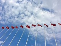 Many Turkish flags waving on the flagpoles.  Royalty Free Stock Photo