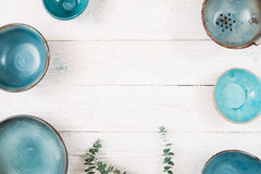 Many turquoise empty ceramic plates. Flat lay Royalty Free Stock Photography
