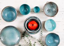Many turquoise empty ceramic plates. Flat lay stock images