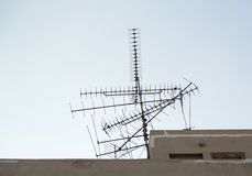 Many tv aerials pointing in directions Royalty Free Stock Photography