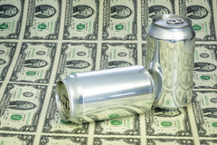 Many two dollar bills and blank cans of beverage Royalty Free Stock Images