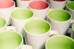 Many two tone color coffee cups Royalty Free Stock Image