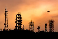 Many type of communication towers  with airplane Stock Photos