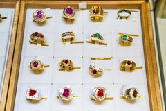 Many type gem ring jewely arrange on the golden plate in the display mirror box Jewely store royalty free stock photo