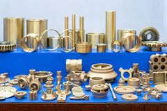Many type and various of industrial metal parts such as vane pump - propeller joint, plug, plate, flange, fitting & other before. And after machining gold color stock images