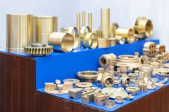 Many type and various of industrial metal parts such as vane pump - propeller plug plate flange & other before and after machining. Gold color or brass royalty free stock image