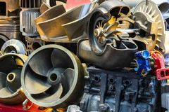 Many type and various of iron casting parts such as housing pump or blower vane propeller blades head cylinder engine etc. by. Process green sand or shell mold stock image