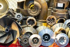 Many type and various of iron casting parts such as housing pump or blower vane propeller blades piston etc. by process green. Sand or shell mold stock images