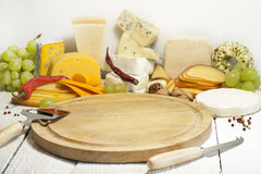 Many types of cheese on cutting board abstract Royalty Free Stock Photo