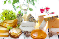 Many types of cheese on cutting board abstract Royalty Free Stock Images