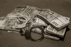 Many Ukrainian money hryvnia. Handcuffs on the money. Corruption in Ukraine. The fight against corruption. Physical evidence of. Corruption in government and royalty free stock image