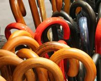 Umbrella handles for sale in the industrial umbrella factory. Many Umbrella handles for sale in the industrial umbrella factory Stock Images