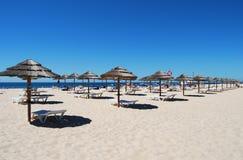 Many Umbrellas on the beach with blue sky in Tavira island,Portugal stock photo