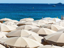 Many umbrellas on the beach Stock Images