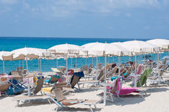Many umbrellas and chairs at a resort in southern Italy Stock Images