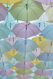 Many Umbrellas hanging in the sky Stock Photo