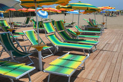 Many umbrellas and sun loungers on the sandy beach of the resort Royalty Free Stock Photos