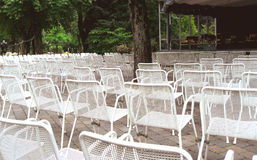Many unoccupied outdoor chairs in front of stage i Royalty Free Stock Photography