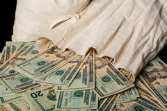Many US dollar bills or notes with money bag Stock Photography