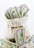 Many US dollar bills or notes with money bags Royalty Free Stock Images