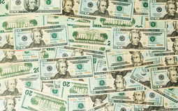 Many US dollar bills or notes on table royalty free stock images