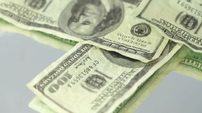 Many us dollar bills spinning on a target. Many us dollar bills spinning against a grey background stock video