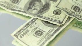 Many us dollar bills spinning on a target stock video
